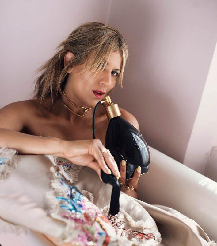 Azzi bathing in perfume